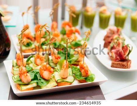 Shrimp appetizers on banquet table, small depth of field