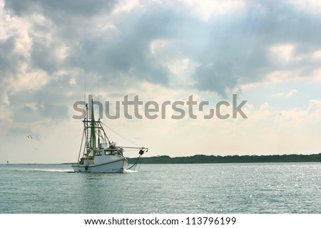 Shrimp boat returning to port in the Gulf of Mexico - stock photo