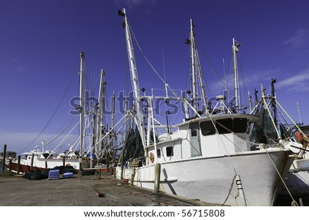 Shrimp Boats in the Gulf of Mexico sitting at dock - stock photo
