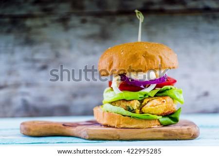 Shrimp burger with fresh vegetables - stock photo