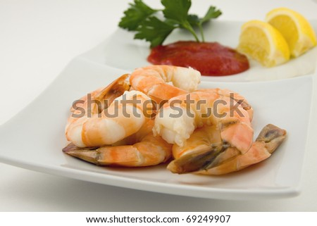 Shrimp cocktail on plate with cocktail sauce - stock photo