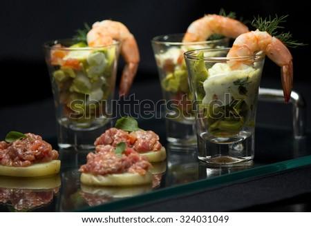Shrimp Cocktail, Shrimp, avocado, fresh tomatoes, onions and cream cheese. - stock photo
