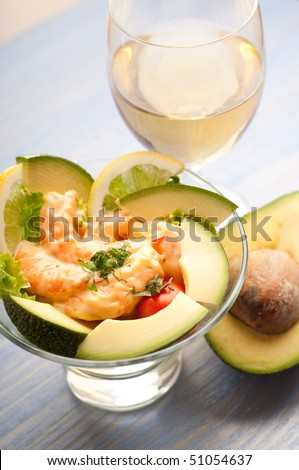 shrimp cocktail with avocado and wine - stock photo