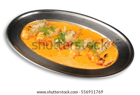 Shrimp curry with garlic isolated on white background