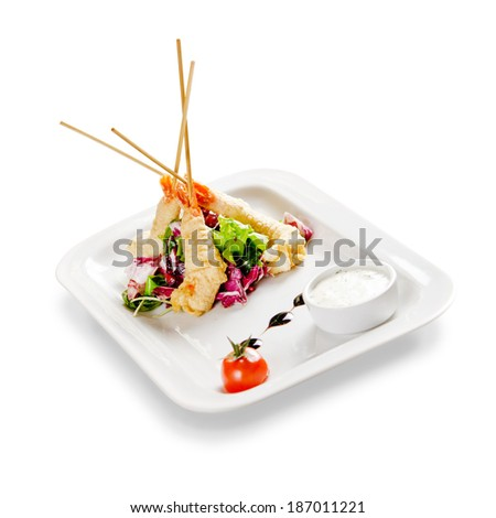 shrimp fried in batter. on a white background