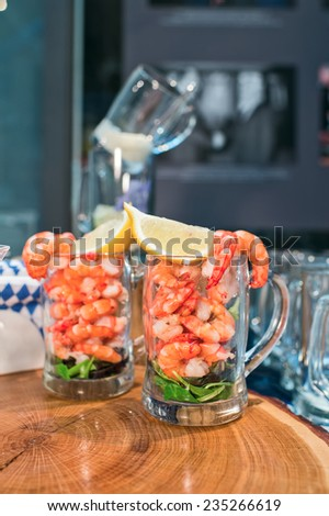 shrimp in a glass with lemon - stock photo