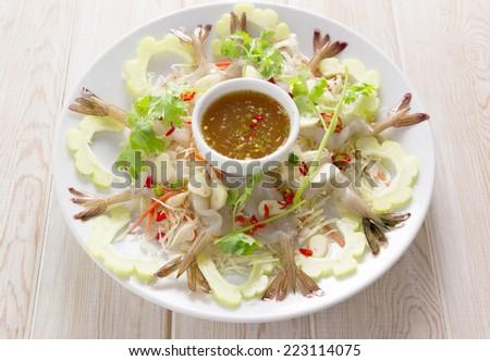 Shrimp in fish sauce Thai sea food on wood table  - stock photo