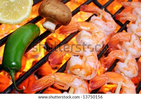 Shrimp kebabs on a hot barbecue grill. - stock photo