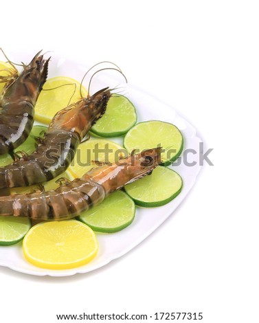 shrimp lemon and lime on plate isolated on white background