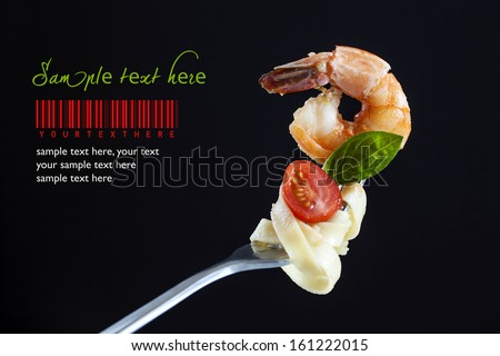 Shrimp Linguine on a fork - stock photo
