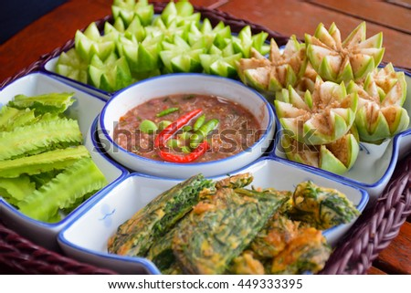 shrimp paste with fresh Vegetable, wood table, white dish,food of Thailand