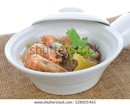 Shrimp potted with vermicelli on white.Thai food