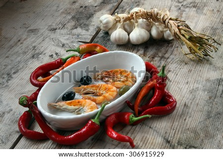 shrimp - prepared fresh seafood scampi on natural organic rustic wooden background - hot pepper - fresh red chili peppers in colors  on organic natural wooden rustic background - stock photo