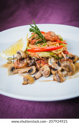 shrimp salad, vegetables and mushrooms - stock photo