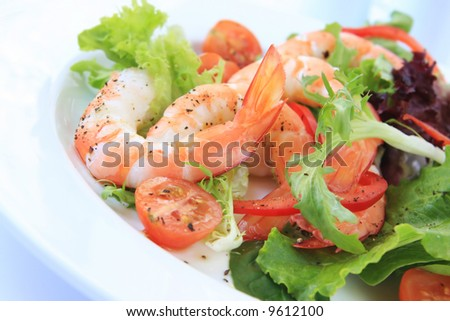 Shrimp salad, with king prawns, mixed greens, cherry tomatoes and capsicum.  Healthy seafood meal.