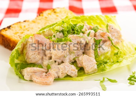 Shrimp Salad Wrap in Lettuce Leaf with slice of Jalapeno Cheese Bread. - stock photo