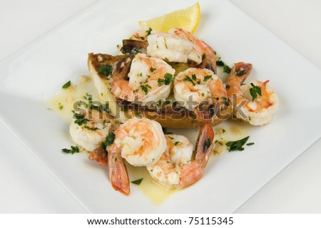 Shrimp Scampi with broiled garlic bread - stock photo