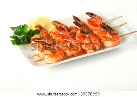 Shrimp skewers with sweet garlic chili sauce on white background - stock photo