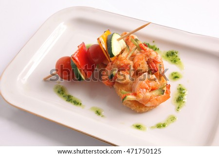 shrimp skewers with vegetables on plate