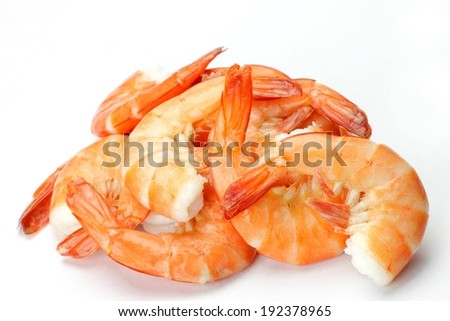 Shrimp tails piled on top of a white table. - stock photo