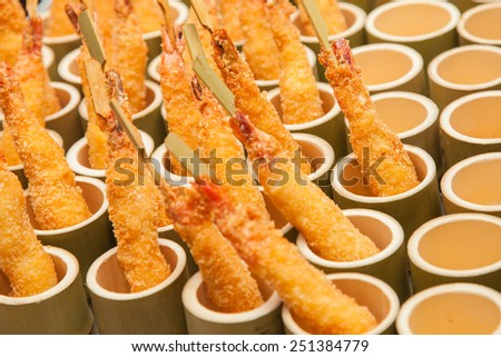 Shrimp Tempura with Chopsticks in bamboo pot - stock photo