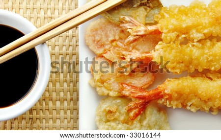 Shrimp Tempura with with vegetables and chopsticks on a white plate. - stock photo