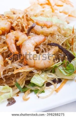 Shrimp with noodles Chinese style - focus shoot - stock photo