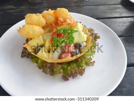 Shrimp with salad and sauce - stock photo
