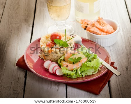 shrimp with salad and vegetables couscous - stock photo