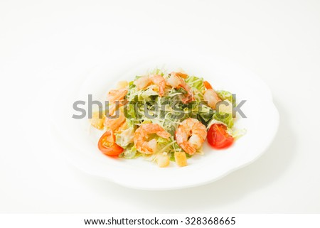 shrimp with vegetables on white plate isolated on white background