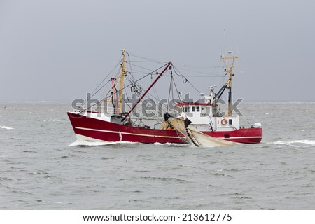 Shrimper at the North Sea not far from Helgoland (Germany) - stock photo