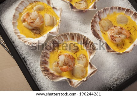 Shrimps and Scallops in Saffron sauce - stock photo