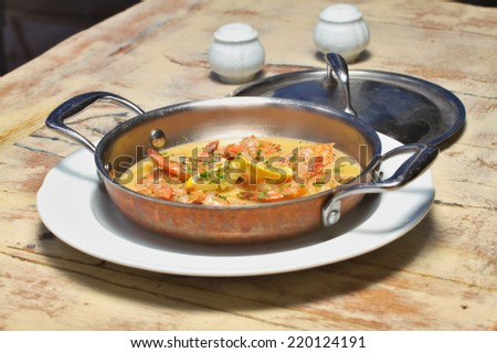 Shrimps in a garlic butter sauce dish  - stock photo
