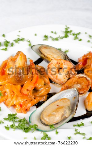 Shrimps mussels and squid tasty seafood dish - stock photo