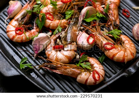 shrimps on a cast iron skillet - stock photo