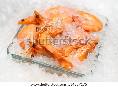 Shrimps on ice market stall close-up - stock photo