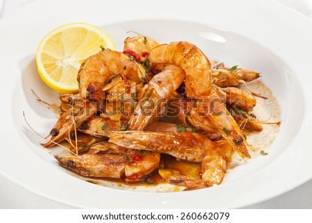 Shrimps prepared with garlic, chili, white wine and balsamic vinegar - stock photo