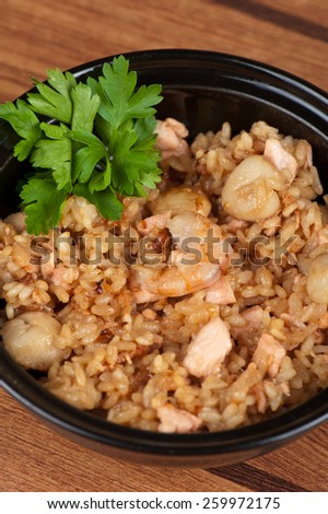 Shrimps risotto garnished with fresh parsley - stock photo