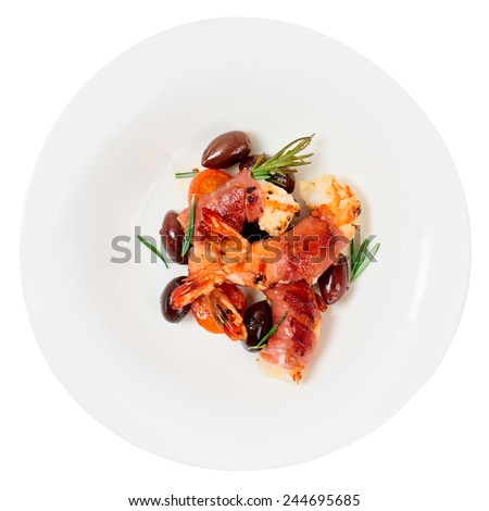 Shrimps with bacon, olives and rosemary in plate, isolated - stock photo