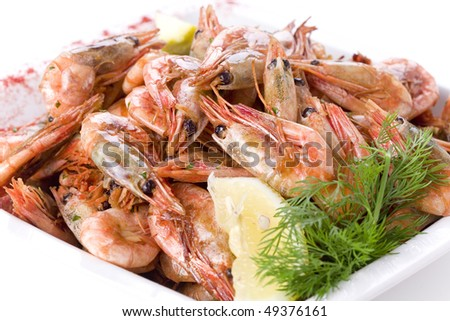 shrimps with dill and lemon on white plate - stock photo