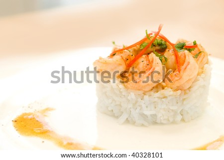Shrimps with lemon sauce on rice - stock photo