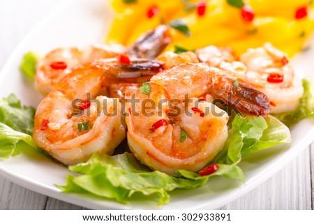shrimps with mango salad - stock photo