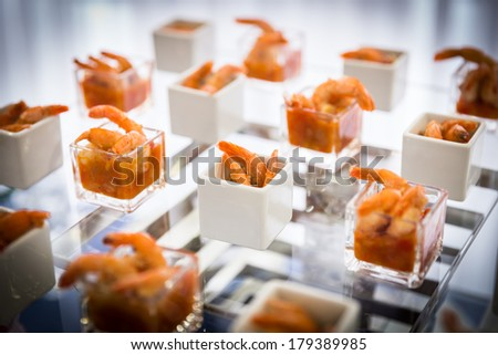 shrimps with sauce served in modern style - stock photo