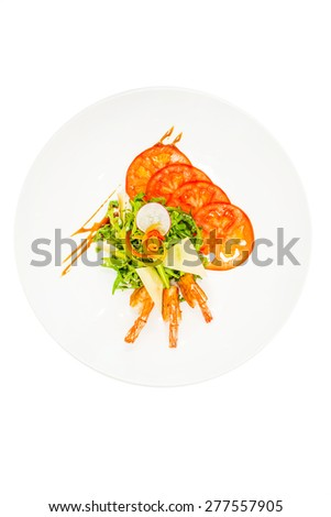 Shrimps with vegetables and cheese on white plate - stock photo