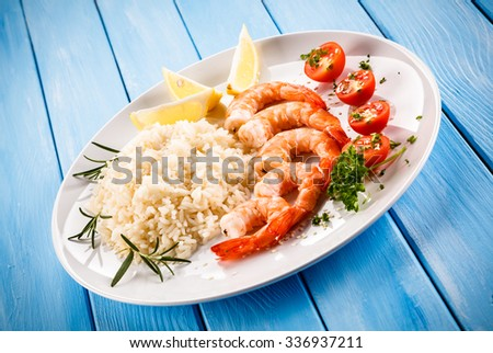 Shrimps with white rice and vegetables - stock photo