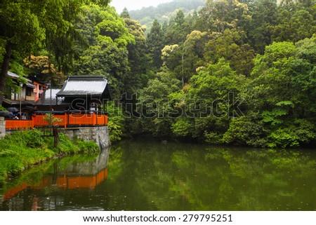 Shrine and pond scene in Kyoto, Japan. - stock photo