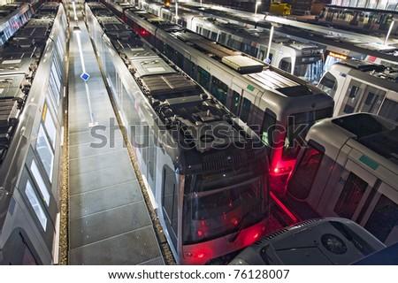Shunting yard and train depot for subways at night - stock photo