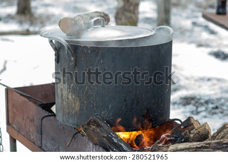 shurpa - soup with meat and potato on the fire