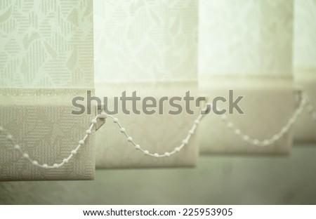 Shutter curtain against sun light on window - stock photo