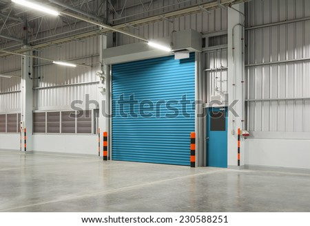 Shutter door or roller door and concrete floor inside factory building use for industrial background.